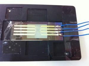 Figure 2: Picture of the calibration glass slide containing 2 parallel 4-points micro RTD probes.